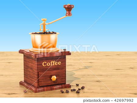 Manual coffee grinder with coffee beans 42697992