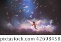 angel boy playing a glowing ball 42698458