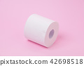 The roll of white toilet tissue paper on pink back 42698518