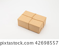 Brown kraft gift wrapped box on white 42698557