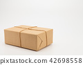 Brown kraft gift wrapped box on white 42698558