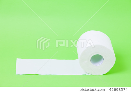 The roll of white toilet eco tissue paper on green 42698574