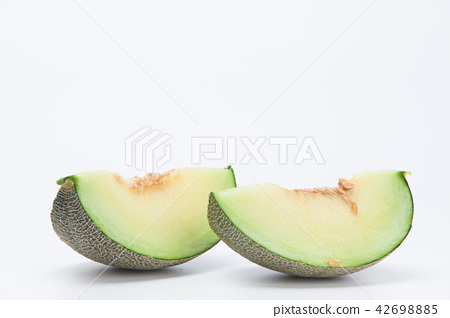 Sliced green cantaloupe melon isolated on white 42698885