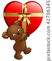 Teddy bear carrying big gift of red heart 42706345
