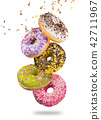 Tasty doughnuts in motion falling on white background. 42711967