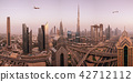 Commercial airplane flying above modern city. 42712112