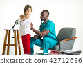 healthcare and medical concept - doctor with stethoscope listening to child chest in hospital 42712656