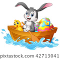 Easter bunny rowing boat with chicks and decorated 42713041