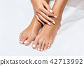 Beautiful female feet with perfect manicure. 42713992