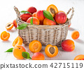 Fresh apricots on a white wooden background. 42715119