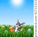 Happy easter rabbit out of holes in the ground 42715353