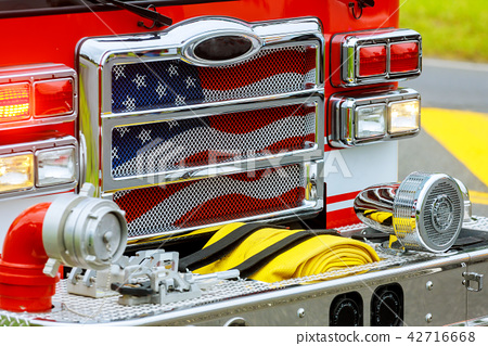 Front of the fire truck at the fire station. 42716668