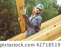 the worker is building the roof 42718519