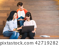 Groups of asian teenage students using laptop 42719282