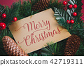 Merry Christmas on gold greeting card on wreath 42719311