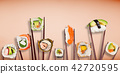 Traditional japanese sushi pieces placed between chopsticks on pastel color background. 42720595