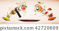 Pieces of delicious japanese sushi frozen in the air. 42720609