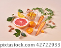 Natural freshly picked fruits- citrus fruits, carrots, sea buckthorn berries on an orange paper. 42722933