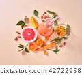 Orange smoothies from orange vegetables and fruits in a glass bottle with orange, grapefruit 42722958