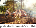 Party, camping of men and women group at forest. They relaxing 42728364