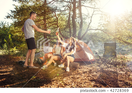 Party, camping of men and women group at forest. They relaxing 42728369