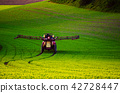 Farm machinery spraying insecticide 42728447
