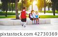Happy children  girlfriend schoolgirl student elementary school 42730369
