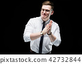 Portrait of confident handsome ambitious happy elegant responsible businessman on black background 42732844