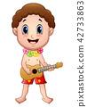Hawaiian boy playing a guitar 42733863
