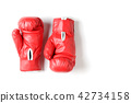 Pair of red leather boxing gloves isolated 42734158