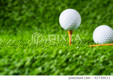 Golf ball with green grass background 42736611