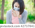 woman get sick 42737641