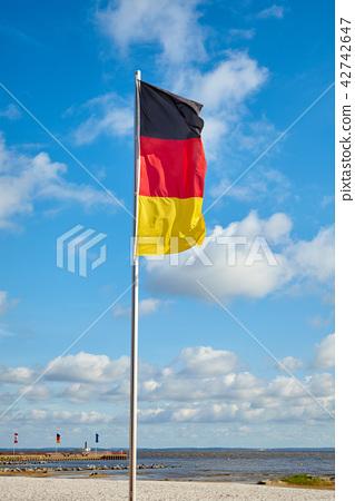 German flag on a pole against the sky. 42742647