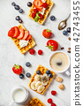 Traditional belgian waffles with whipped cream and fresh fruits  42743455