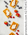 Traditional belgian waffles with whipped cream and fresh fruits  42743457