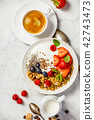 Healthy breakfast with coffee, yogurt, granola and berries 42743473