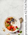 Bowl of homemade granola with yogurt and fresh berries 42743476