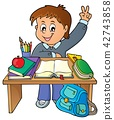 Boy behind school desk theme image 1 42743858
