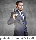 Bussinessman in suit with baseball bat 42745500