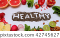 Healthy colorful vegetables and fruits on white 42745627