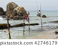 Stilt fishermen on the beach of Kog 42746179