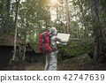 backpacker searching direction on location map  42747639