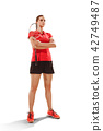 Young woman badminton player standing over white background 42749487
