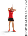 Young woman badminton player standing over white background 42749502