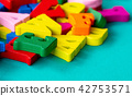 closeup of colorful wooden alphabet on green 42753571
