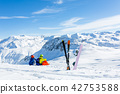 snowboarder and skiier sitting on snow and see at mountains 42753588