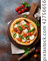 Italian pizza with tomatoes, mozzarella and basil 42756656