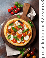 Italian pizza with tomatoes, mozzarella and basil 42756658