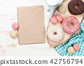 Milk and donuts on wooden table 42756794