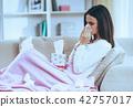 Sick Brunette Blows Nose. 42757017